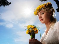 Andrejs Pidjass                     : Beautiful woman with dandelion flowers over blue sky